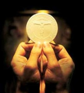 eucharist held in hands