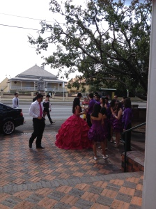 "Albita arriving at the church with her ""court"""